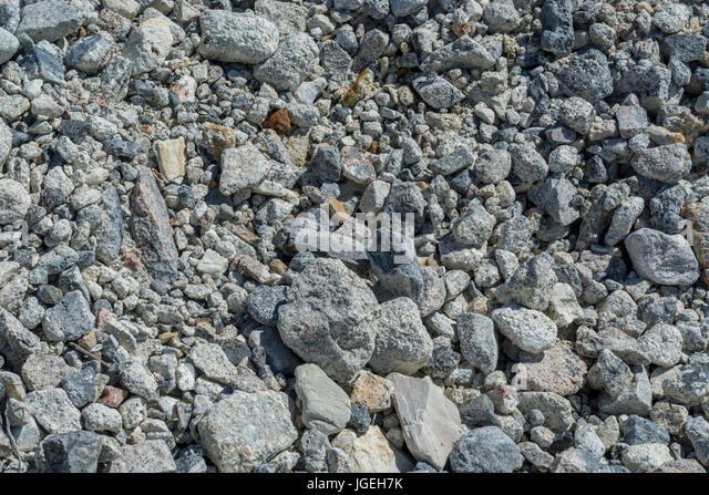 Pile of small granite rocks. Concept 'fall on stony ground', warnings ignored. etc. - Stock Image