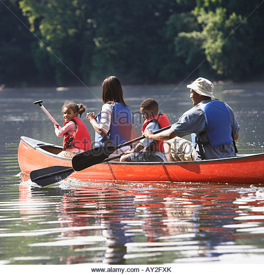 African American family in canoe - Stock Image