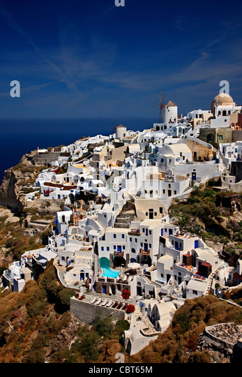 The west part of Oia village, with its famous windmills, hanging over the cliff. Santorini island,  Cyclades, Greece - Stock-Bilder