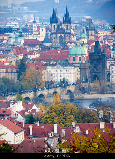 View from Petrin to Stare Mesto with Charles Bridge in middle distance in Prague in Czech Republic - Stock Image