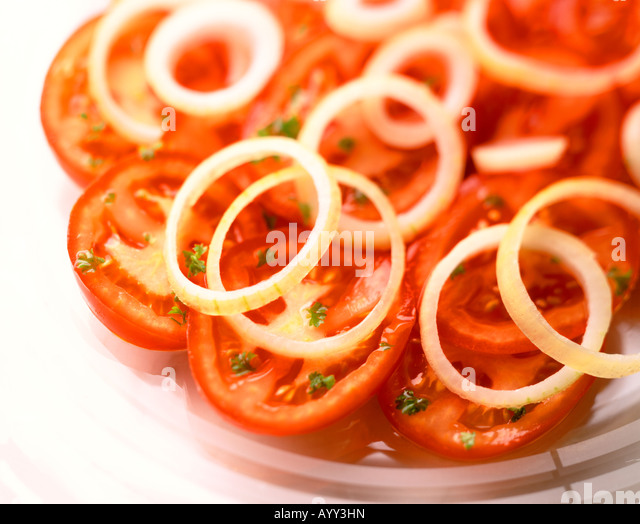 SHOT OF A FRESH TOMATO AND ONION SALAD - Stock Image