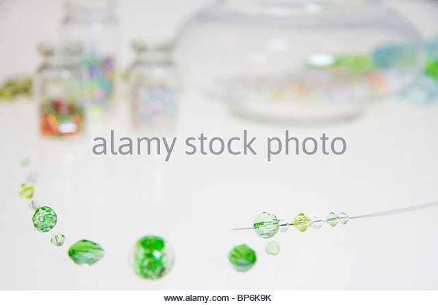 Bead and thread, Close-up - Stock Image