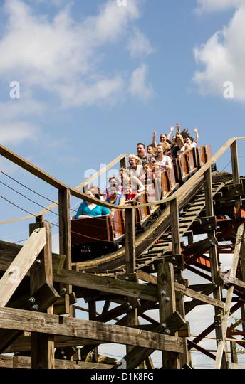 Legoland Florida Coastersaurus wooden roller coaster ride with tourists raising their hands, Winter Haven, FL - Stock Image