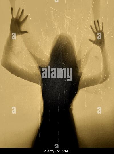Woman silhouette with arms up - Stock-Bilder