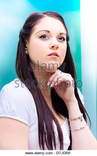 Closeup On The Face Of A Beautiful Brunette Business Woman Thinking Pondering And Deliberating Business Decisions - Stock Image