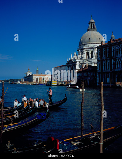 Canal Grande with gondolas transporting people Venice, UNESCO World Heritage Site, Italy,  Europe. Photo by Willy - Stock Image