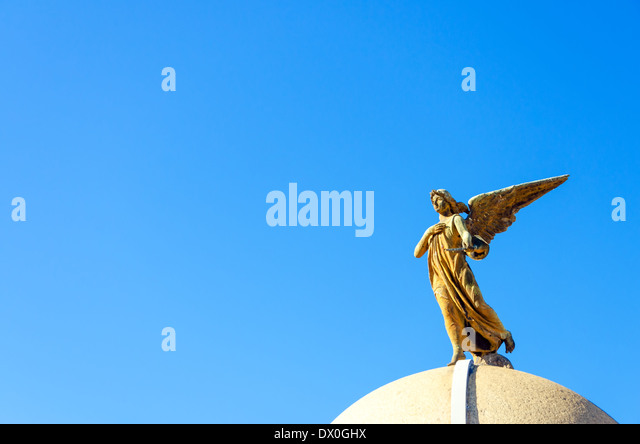 An angel on top of a tomb in the Recoleta Cemetery in Buenos Aires - Stock Image