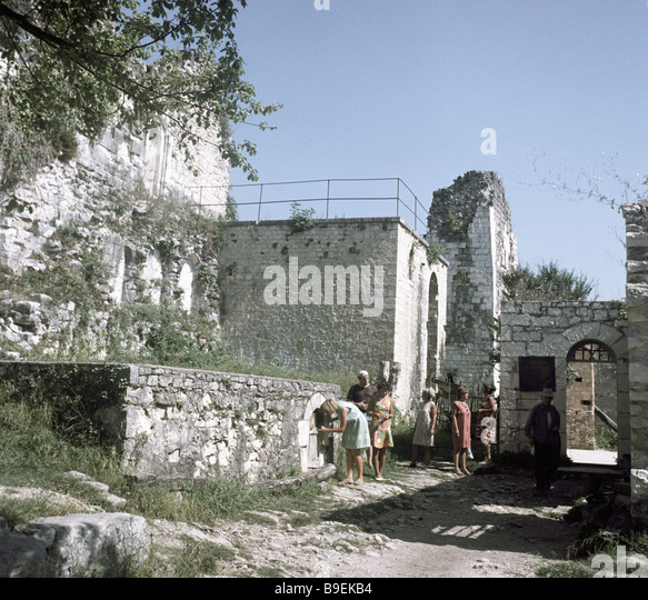 Sightseers inspecting the historical archival preserve on Iverskaya Mount at Novy Afon - Stock Image