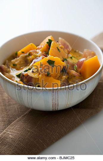 Bowl of Thai Pumpkin Curry - Stock Image