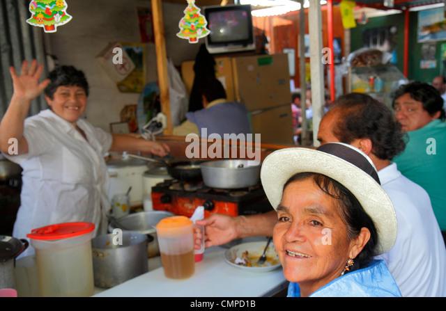 Lima Peru Barranco Jiron Union Mercado Union market marketplace food vendor restaurant budget Hispanic indigenous - Stock Image