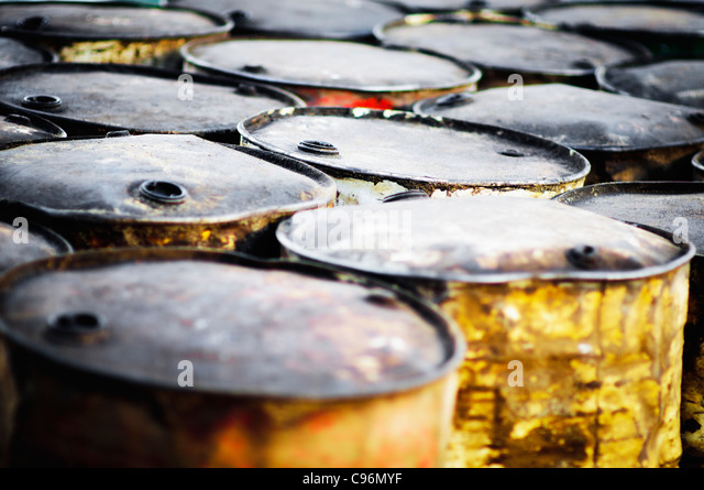 Old rusty oil barrels on the beach of Gili Meno in Indonesia - Stock-Bilder