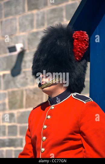 The Citadel military guard in red coat at attention in front of guard house in old Quebec City, Canada - Stock Image