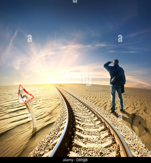 Man and the railway in the desert - Stock Image