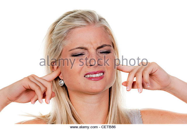 young woman suffers from noise pollution, covers his ears. - Stock Image