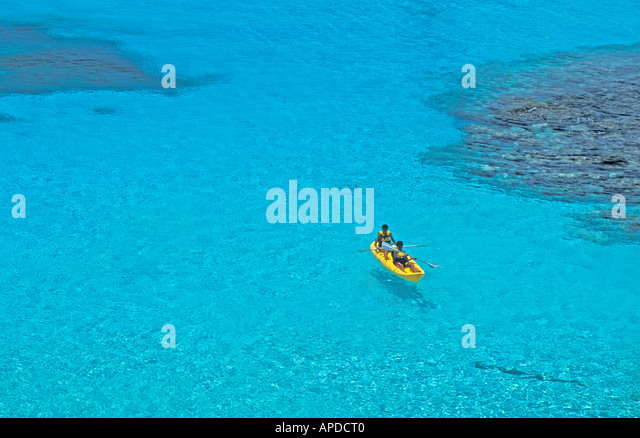 Tropics tropical yellow kayak from above overhead aerial view at Garrafon natural reef Park ecological park Isla - Stock Image