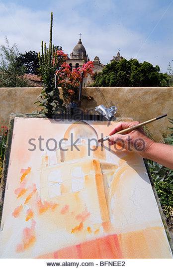 Diane Lee painting outside the Carmel Mission. - Stock-Bilder
