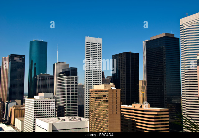 Houston Texas tx skyline skyscrapers buildings against clear blue sky downtown - Stock Image
