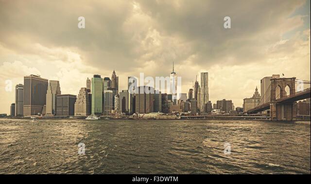 Retro toned stormy sky over Manhattan, NYC, USA. - Stock Image