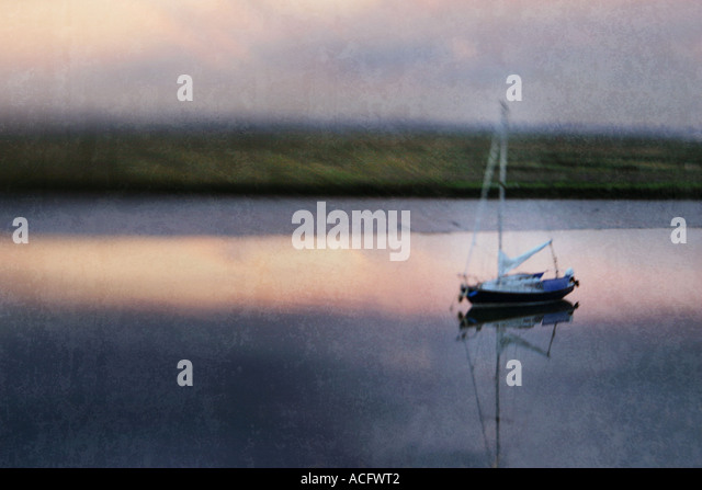 Photo of a boat moored in an estuary - Stock Image