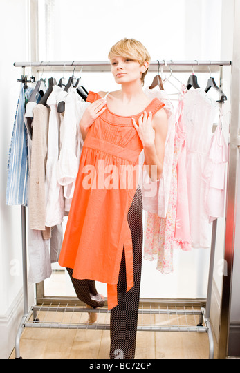 woman choosing clothes - Stock Image