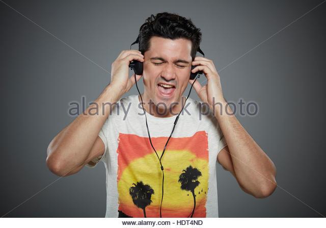 Portrait of young man wearing headphones. - Stock Image