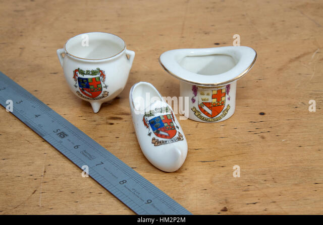three pieces of Goss and Goss lookalike china inscribed Framlingham and a shield - Stock Image