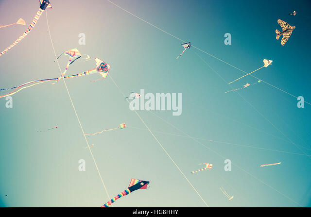 kites flying in the sky  with strings - Stock Image