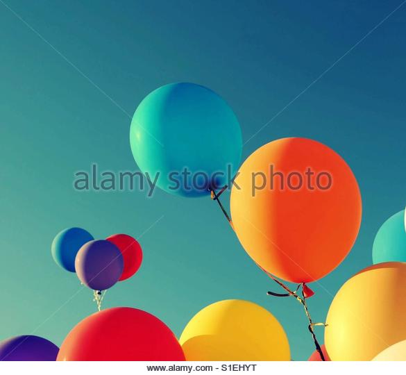 Balloons in the bright sky - Stock Image