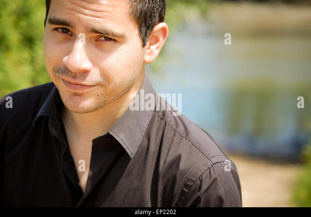 Portrait of a man looking at camera - Stock Image
