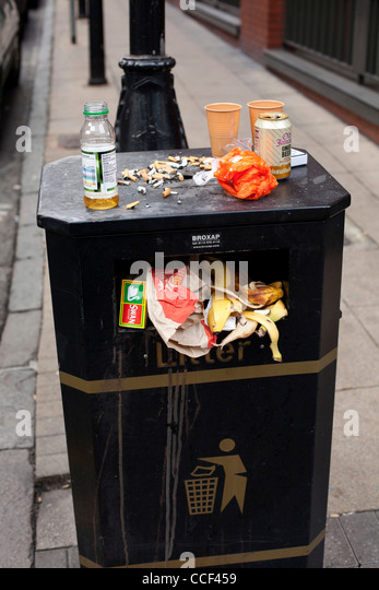 An overflowing rubbish bin in Barwick Street, Central Birmingham, UK. Nearby office workers use the bins in this - Stock Image
