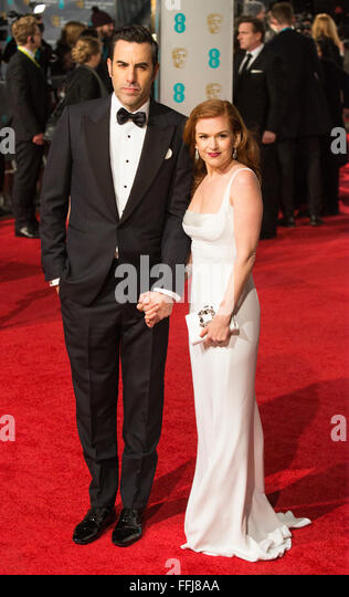 London, UK. 14 February 2016. Sasha Baron Cohen with Isla Fisher. Red carpet arrivals for the 69th EE British Academy - Stock Image