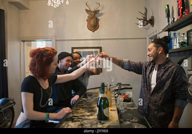 Group of friends at a bar. - Stock Image