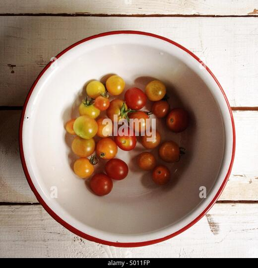 Cherry tomatoes harvested from an urban garden. - Stock Image