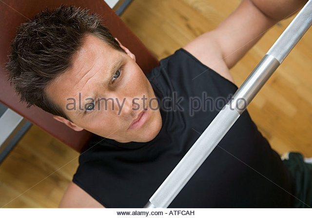A man weightlifting - Stock Image