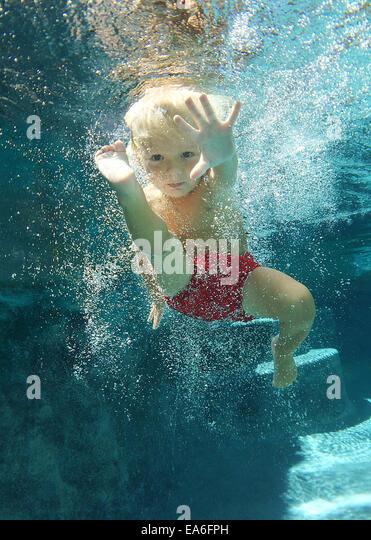 Boy (2-3 years) swimming underwater - Stock Image