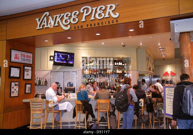 California San Francisco International Airport SFO gate area concourse terminal Yankee Pier food restaurant bar - Stock Image