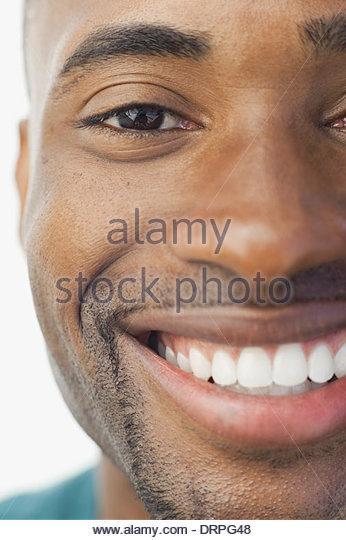 Cropped image of smiling man - Stock Image