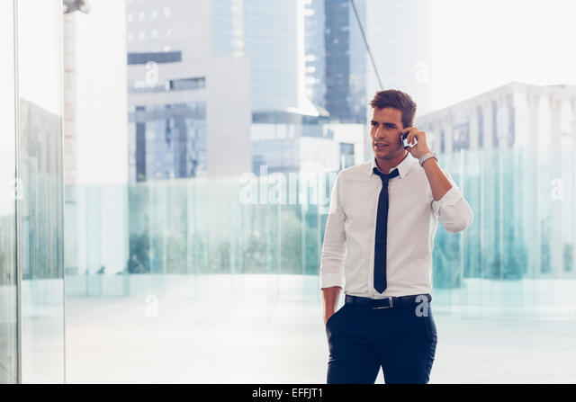 Businessman using a mobile phone - Stock-Bilder
