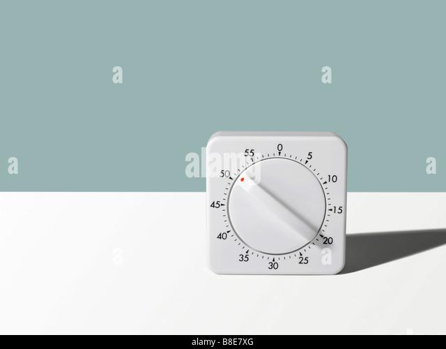 Studio shot of a wind up Kitchen Timer - Stock Image