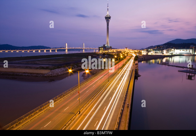 View from bridge of Macau Sky tower at dusk - Stock Image