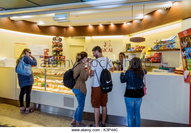 Lisbon Portugal Metro Lisboa subway Marques de Pombal station cafe coffee counter man woman pastries interior customers - Stock Image