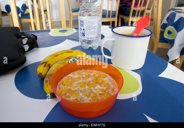 cheap cereal bananas and coffee breakfast at a hostel in Iceland - Stock Image