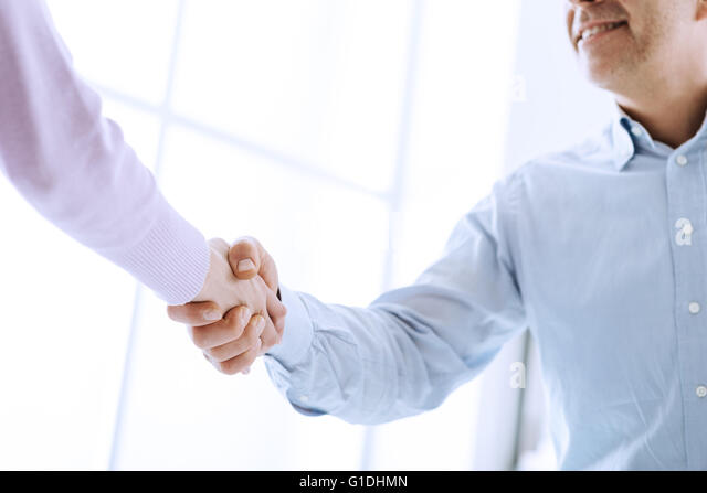 Business people shaking hands after a successful meeting, business relationships and cooperation concept - Stock Image