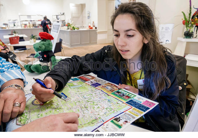 South Carolina Charleston SC Historic Downtown Gibbes Museum of Art gift shop map direction assistance woman young - Stock Image