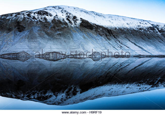 Tallla Reservoir, Moffat, Scotland, UK. 25th November 2016.   A Snow topped Garelet Hill (680m) is reflected in - Stock Image