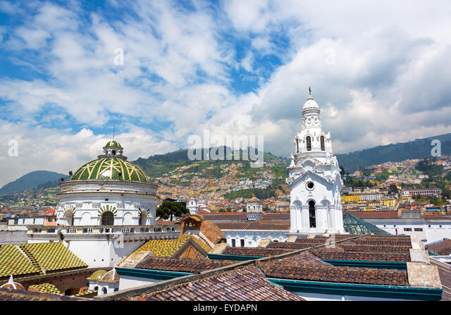 Cathedral with populated hills visible in the background in the historic colonial center of Quito, Ecuador - Stock Image