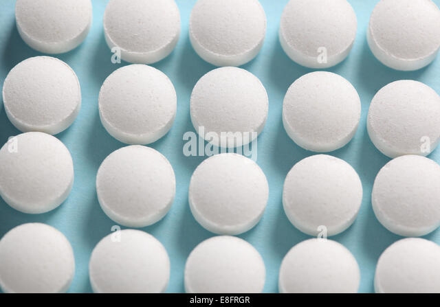 Pills in row - Stock Image