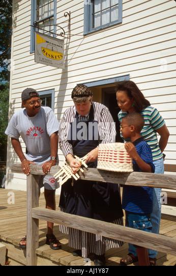 Ohio Columbus Ohio Village recreated Civil War era town interpreter basket weaving Black family - Stock Image