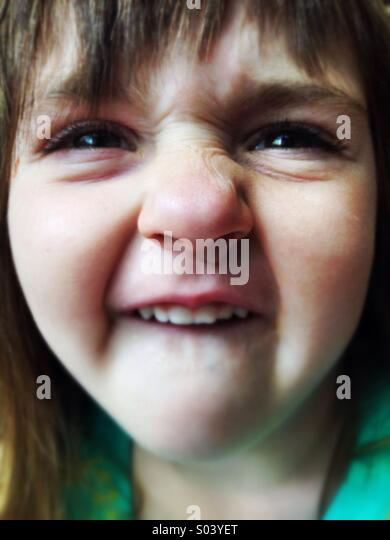 Silly Caucasian smiling goofy face girl - Stock-Bilder