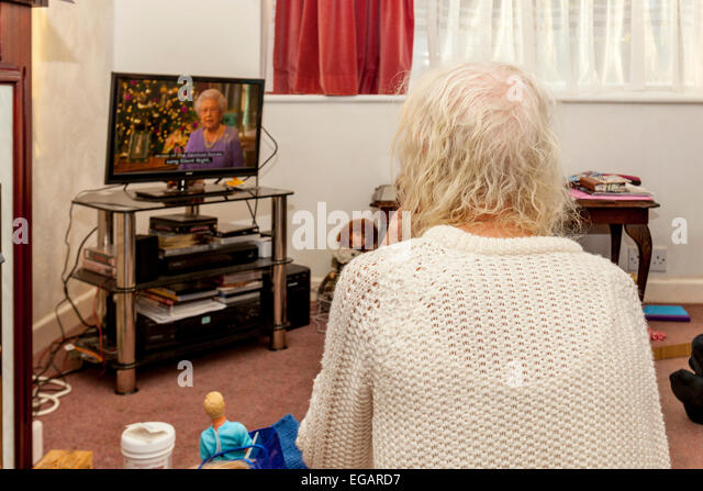 An Elderly Woman Watches The Queen's Speech On Television, Sussex, England - Stock Image